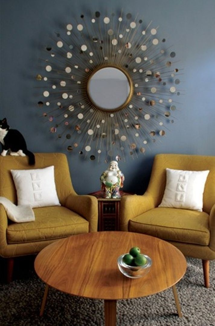 Mid-century living room with atomic mirror.