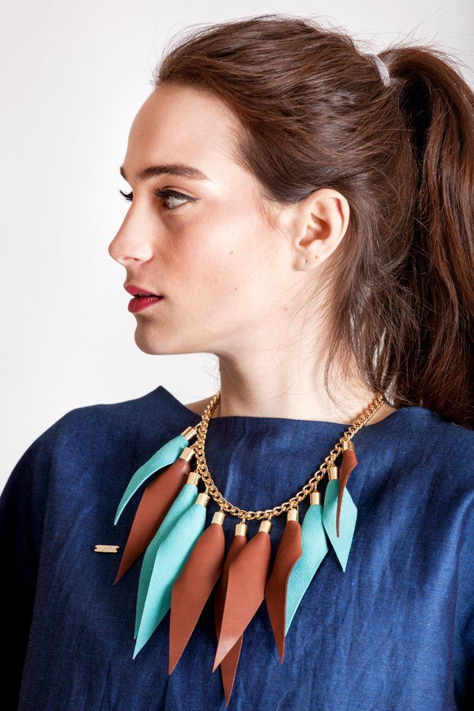 Wild child necklace in cognac brown and turquoise / gold features leather spikes with galvanized brass and metal components.