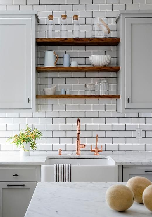 Light Gray And White Kitchen Boasts A Farmhouse Sink Paired With Copper Gooseneck Faucet Fixed