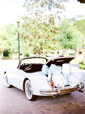 Classic wedding car filled to the brim with Tiffany blue presents! | photography by http://portfolio.shiprapanosian.com/