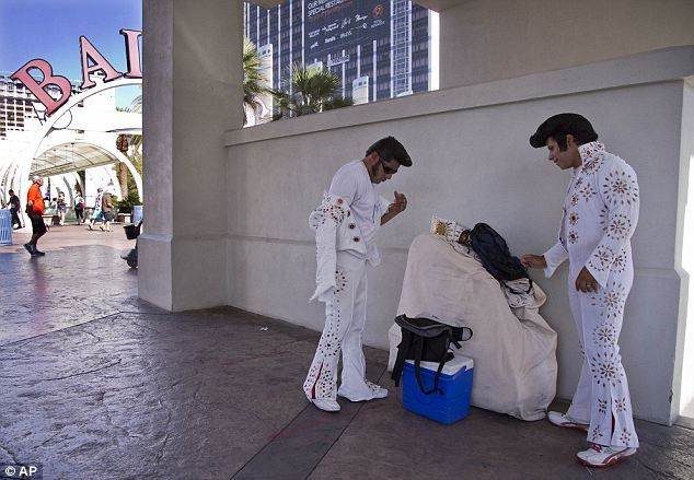 No break for the king: Elvis impersonators decided the show must go on and they wore their hot jumpsuits on Thursday
