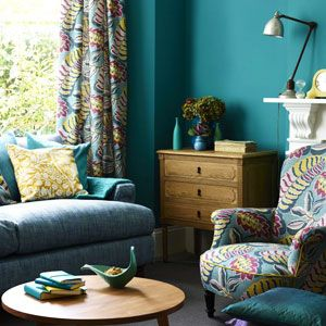 Teal is a sophisticated cool colour. The warm purple and yellow hues are warm accents which create balance in this scheme. Colour inspiration may come from a fabric design.  Tip- When using pattern in a room vary the size of the prints from large to small and always use plain or textured fabrics to give relief from the pattern.