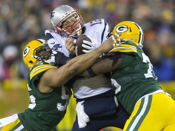 New England Patriots quarterback Tom Brady (12) is sacked by  the Green Bay Packers