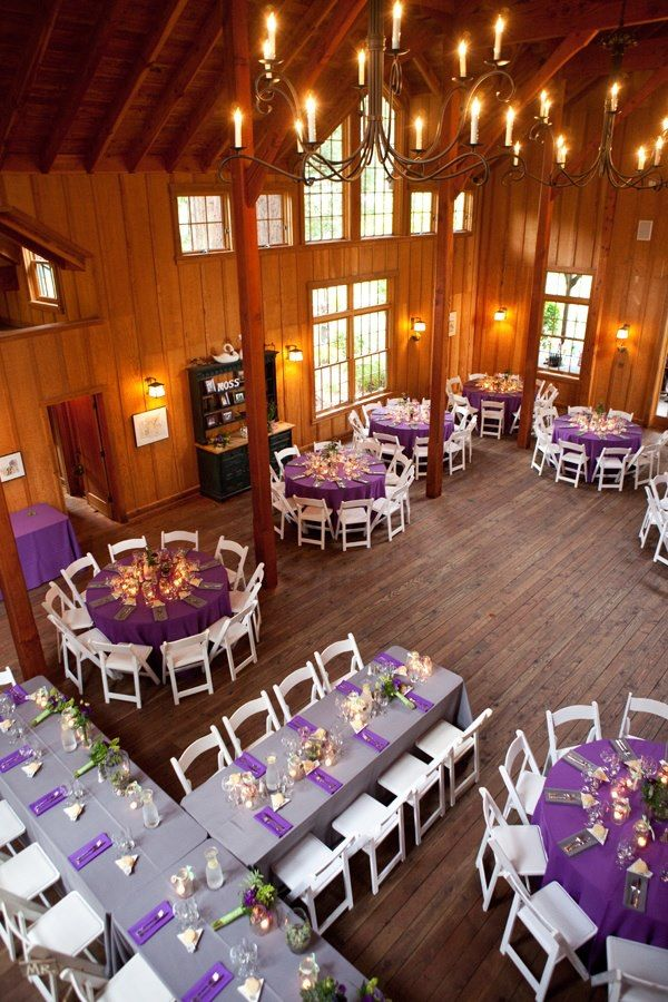 Think I would make the head table the dark purple with grey accents and other tables grey with purple accents.. but love the set up!