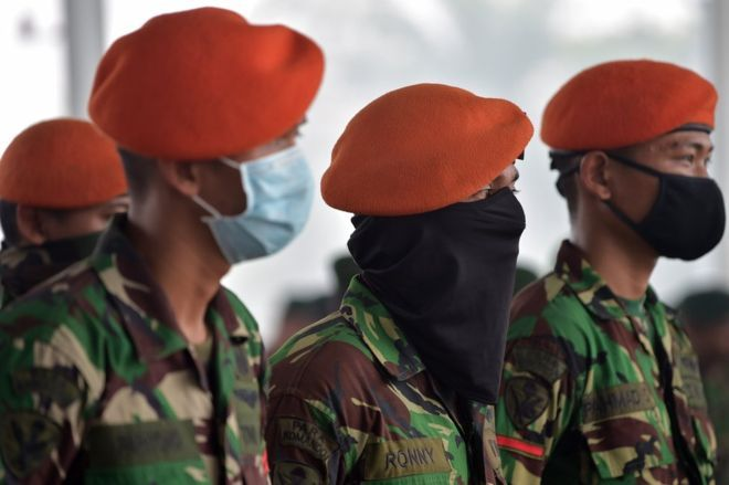 Members of the Indonesia Air Force attend a military roll call at the Roesmin Noejadin Military airport before reinforcing firemen as they combat fires in Pekanbaru, Riau province on 15 September 2015