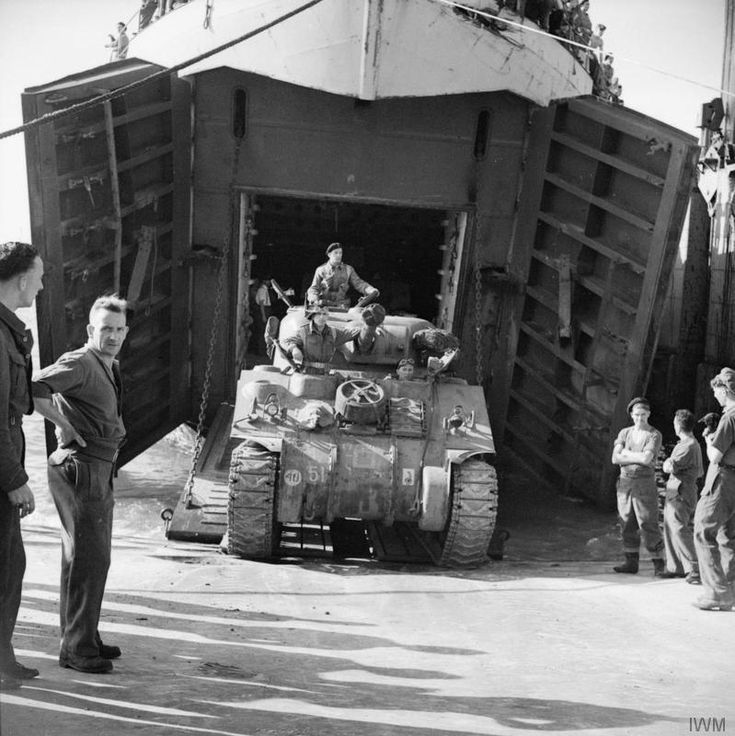 "THE POLISH ARMY IN THE NORMANDY CAMPAIGN, 1944 - A Sherman tank of the ""B"" Squadron, 1st Armoured Regiment (10th Armoured Cavalry Brigade, 1st Polish Armoured Division) disembarking from an LST onto the Mulberry artificial harbour at Arromanches, 26-28 July 1944."