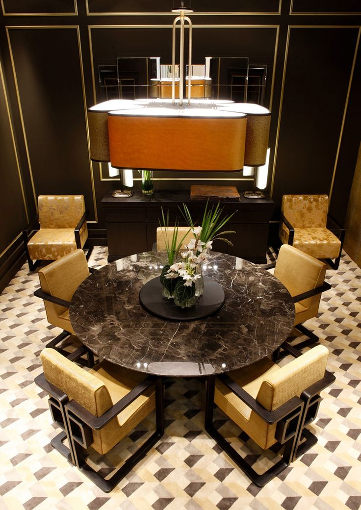 Oasis Group booth at Milan Salone del Mobile 2015. Table top by Mistic Brown italian marble, design by Massimiliano Raggi.