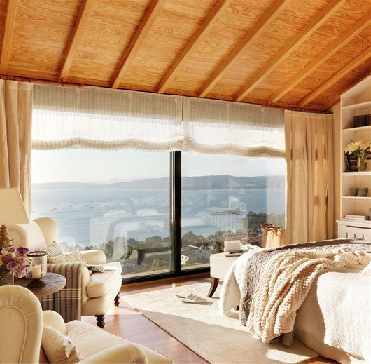layering of shades and curtains diffuse light wout blocking view in spanish style bedroom