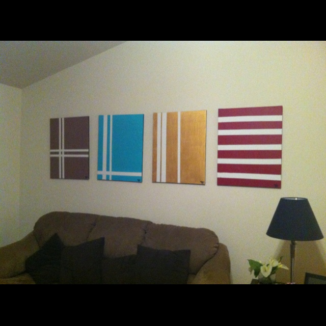 DIY canvas set. I made these a few years ago when we just moved into our new house. Pretty much all I used was painters tape and painted the canvas 1 color then removed the tape.