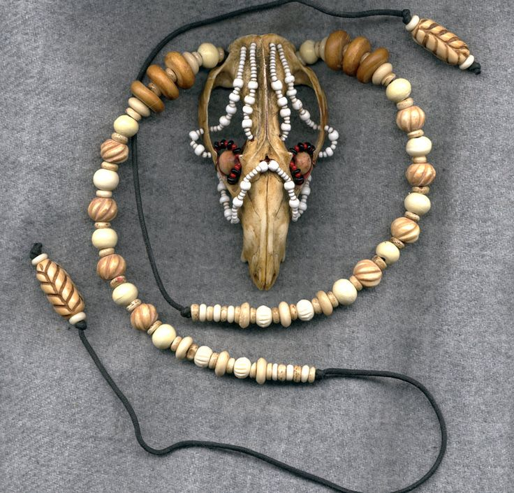 Possum skull necklace with bone and glass beads, by DonSimpson, DeviantArt. This guy does some awesome stuff!