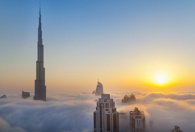 Currently the world's tallest building, the Burj Khalifa towers 2,717 feet above the ground. Built by SOM, the Burj includes a sky lounge with sweeping views of the Persian Gulf.