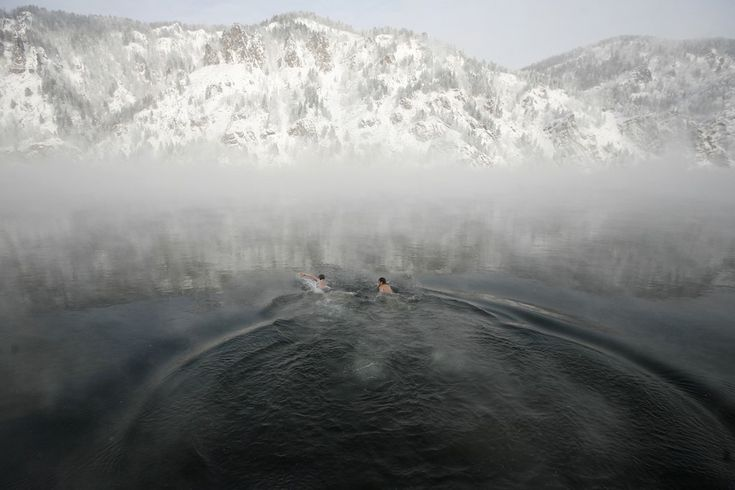 Members of a local winter swimming club Alexander Klyukin, left, and Vladimir Korabelnikov swam in the Yenisei River during their weekly session in the town of Divnogorsk, Siberia, Friday. The temperature was around minus 22 degrees Fahrenheit. (-5 degrees Celsius)