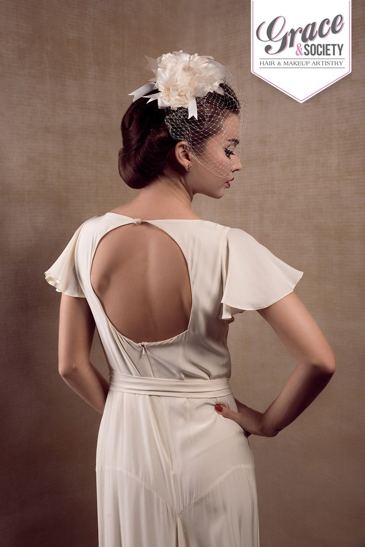 Hair up in a 1940's roll to show off the back of the dress. #Vintagewedding