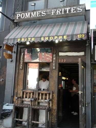 Pommes Frites is a tiny sliver of a food-establishment that serves up authentic Belgian frites, in Belgian frites-stand style: with a variety of sauces, and in a paper cone. (123 2nd Avenue, between 7th & St. Marks Place.) ~ Concentrating on one item and making the best!