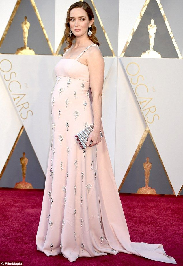 Subtle style: Arriving at the city's famous Dolby Theatre alongside the great and the good of Hollywood, the 33-year-old actress looked stunning as she subtly concealed her blossoming bump in a loose pink gown #TheExpectantEdit
