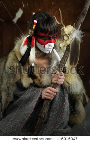stock photo : Painted face, native american woman with war mask. Cracked paint. Young shaman girl with deer skull staff part of large series of painted tribal portraits