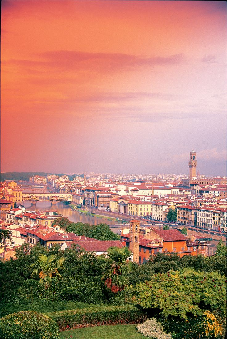 A skyline view of Florence with the Arno River and the Ponte Vecchio bridge