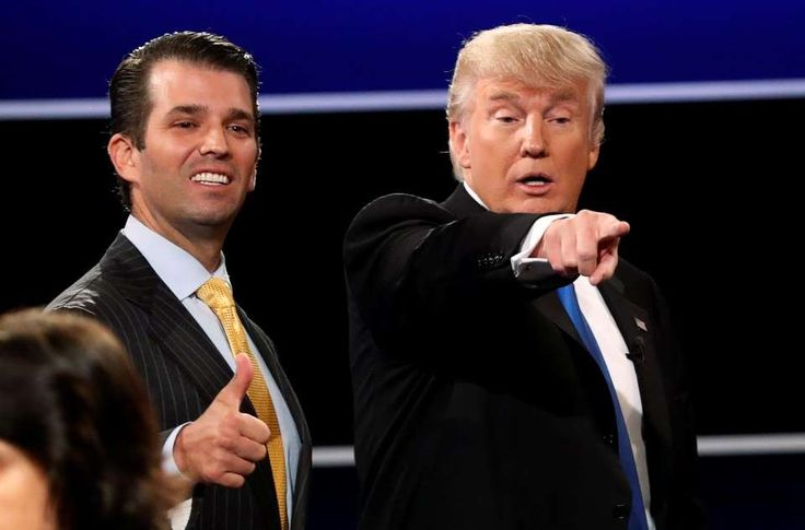 Donald Trump Jr., Donald Trump standing next to a man in a suit and tie: Donald Trump Jr. gives a thumbs up beside his father, then-candidate Donald Trump, after Trump's debate last year against Hillary Clinton at Hofstra University in Hempstead, N.Y. (Mike Segar/Reuters)