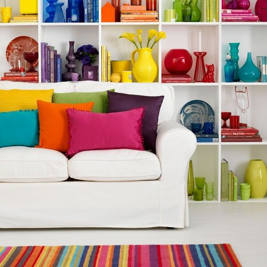 Alternative living room theme - rainbow! White walls, and then coloured things that are same tone as sofa but different colours! Kind of love it, but kind of not sure. Am I too old for this? Morrocan may be more relaxing environment but this would make people smile!   Picture that inspired me turned out to be a dodgy link, so had to look for others.
