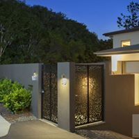 """Entry Gates : Private Residence St Lucia Brisbane Urban Metal Custom Designed entry gates in """"Leaves"""" design.  Material : Powder coated aluminium Landscape Architect : Utopia Landscape Design Landscaper : Landscape Surrounds"""