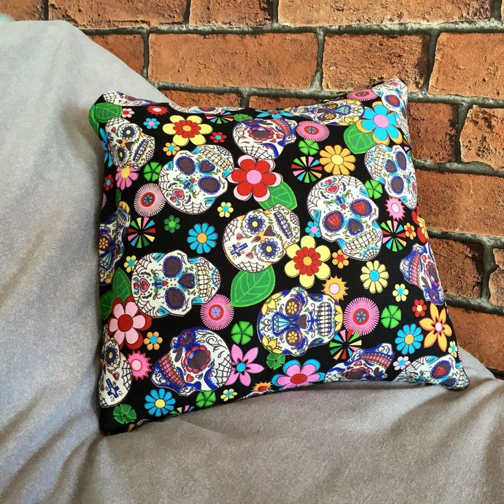 A personal favourite from my Etsy shop https://www.etsy.com/uk/listing/268815984/sugar-skull-cushion-skull-pillow