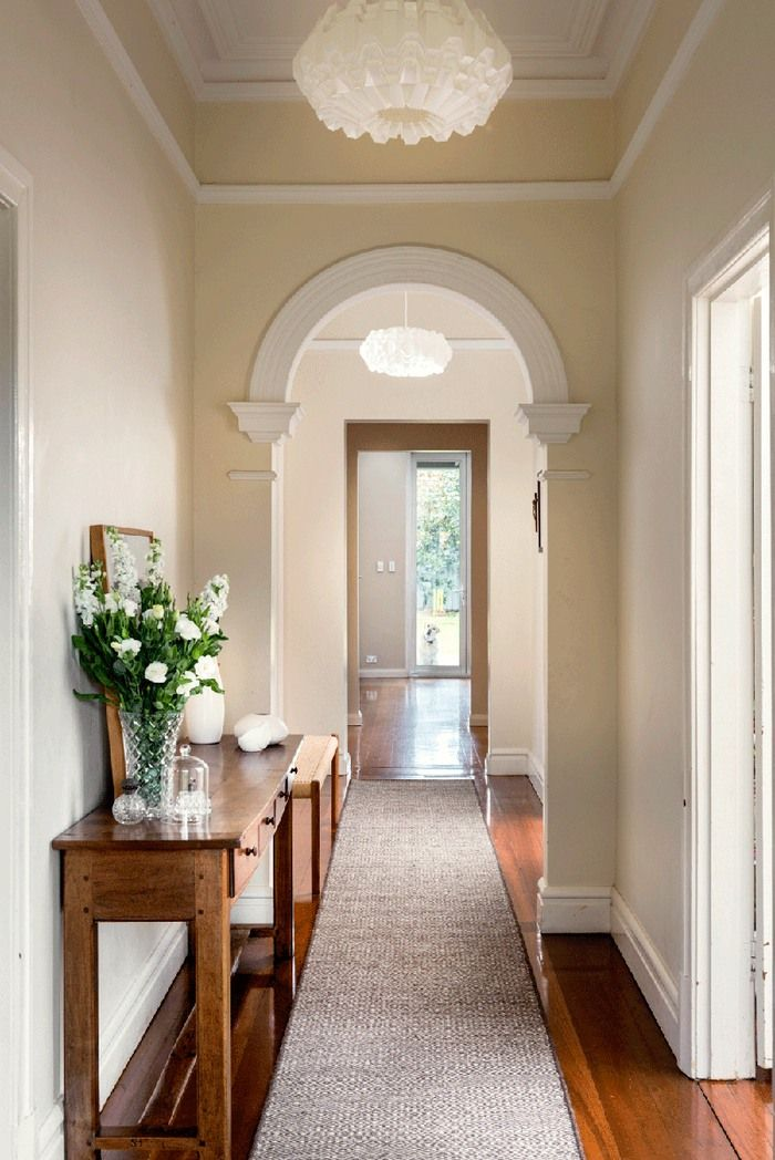 Elegant hallway styled by Collected Interiors featuring a custom…
