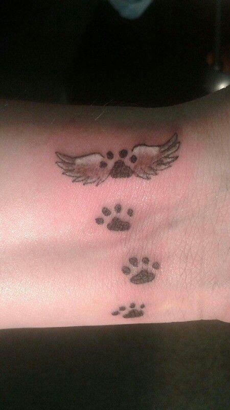 Angel wing paw print tattoo