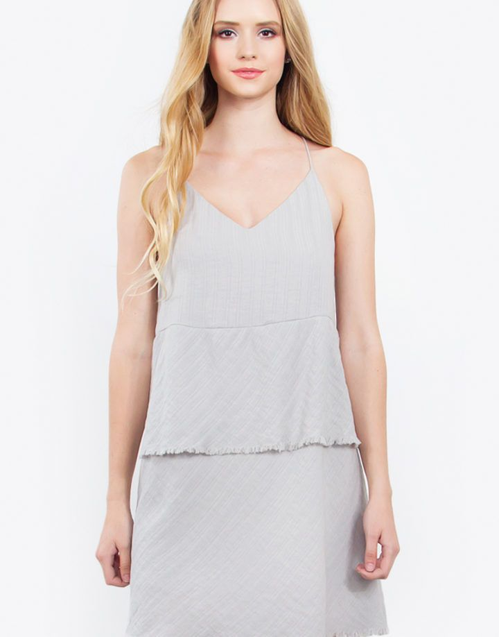 – Layered cami dress with a fray hem – V neck line – Lined – Color: Grey  Size + Fit – Model is wearing size S – Measurements taken from size S – Length: 30″ – Waist: 36″ – Chest: 35″