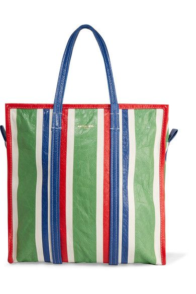 Inspired by traditional market carryalls, Balenciaga's textured-leather tote is boldly striped with shades of green, navy, red and white. Its spacious interior is thoughtfully organized with zipped and patch pockets to stow away your cell phone, keys and wallet. We think it's the perfect size for busy weekends and traveling.
