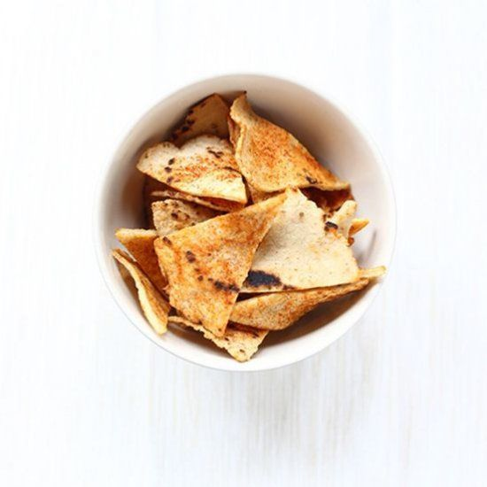 These oven baked corn tortilla chips are easy to make and you can flavour them anyway you like.