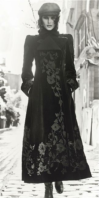 Long black coat with cascading floral print