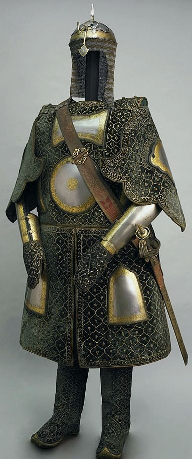 Chilta hazar masha (coat of a thousand nails), kulah khud (helmet), bazu band (arm guards). Indian armored clothing made from layers of fabric faced with velvet and studded with numerous small brass nails, which were often gilded.  Fabric armor was very popular in India because metal became very hot under the Indian sun. This example has additional armor plates on the chest area, arms, and thighs. The Wallace Collection, London England.
