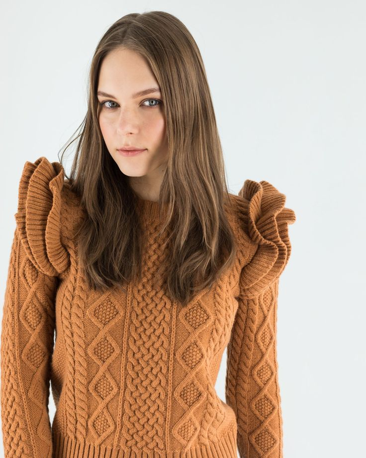 Ruffles blaze. The fisherman sweater with its soft yarn and its braided pattern marks our winter look but here, we decided to further celebrate it as a truly iconic and very feminine piece. Available in five super pop colors. This weekend's new-ins on www.lazzarionline.net and in our stores. #Lazzari #LazzariStore #LazzariGirl #fisherman #winterlook #ruffles #feminine