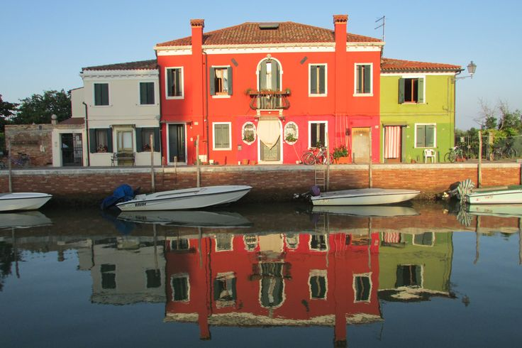 Reflections of homes on Mazzorbo Island Italy