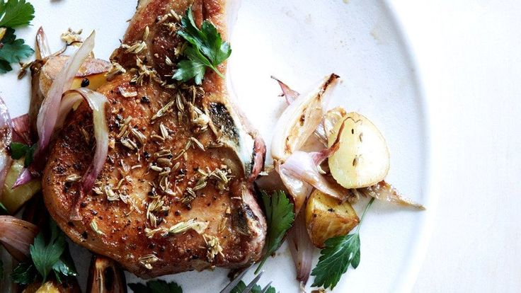 These Fennel-Crusted Pork Chops with Potatoes and Shallots—sauce included—can be made in one pan.