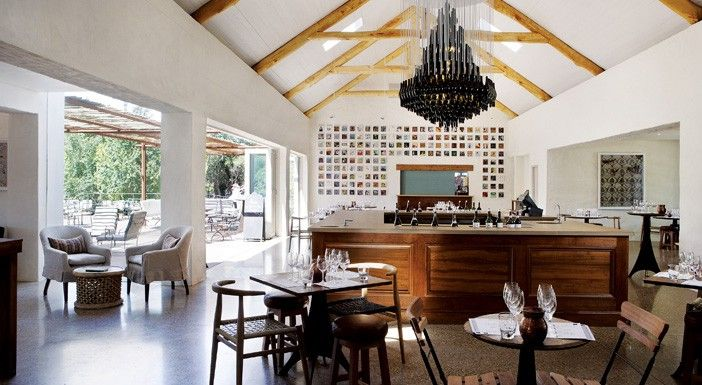 Renowned artists Heath Nash made the chandelier above the Spier tasting counter from 334 recycled #Spier wine bottles, weighing 370kgs.