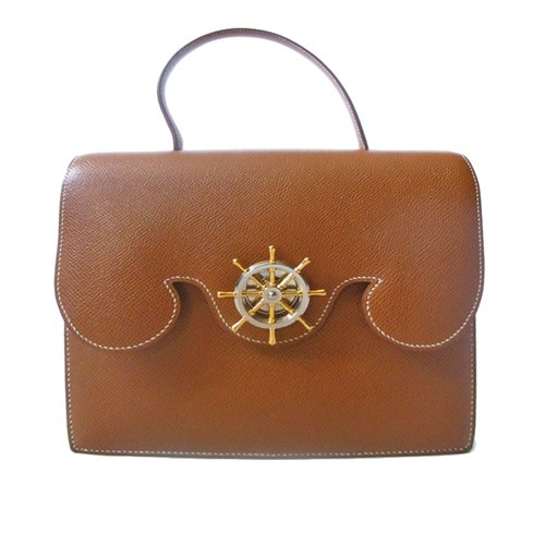 Hermes brown leather purse with nautical wheel clasp - $2040.