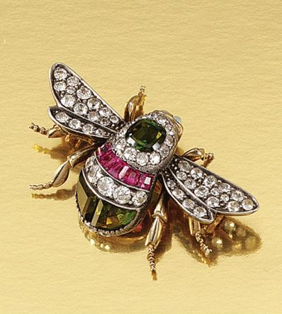 GEM-SET BROOCH, LATE 19TH CENTURY Designed as a bumble-bee, the body decorated with three tourmalines of green tint and a row of calibré-cut red stones, the eyes embellished with cabochon opals, the wings and body further highlighted with circular-, rose- and single-cut diamonds, safety chain deficient.