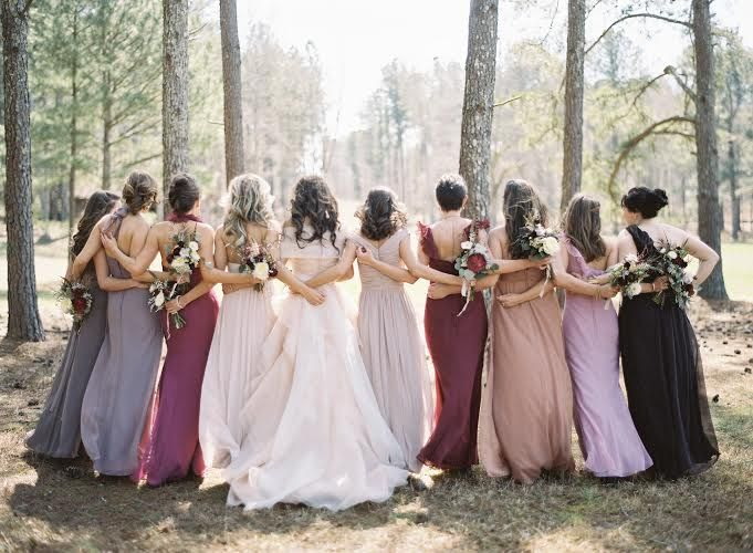 Gorgeous scheme for a fall wedding -- we're thinking wine country? This party proves that establishing a few tones and specifying dress length can make it easy for a wide variety of dresses to come together in harmony.