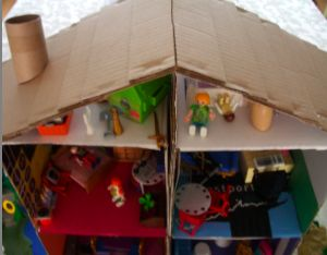 Cardbpard box playhouse how to.  Make a shopping mall, a building, a house.  Many plans to download :)   Use lots of recycle materials inside, mix and match toys, too!  Green Play for kids,
