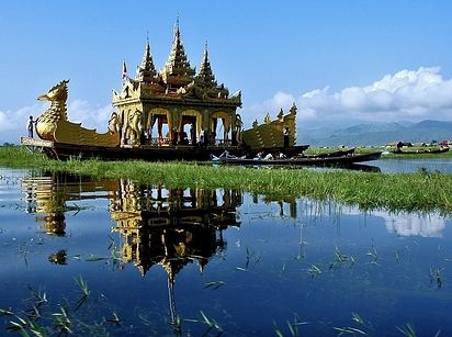 Inle Lake, Myanmar | The Nyaung Shwe township of Myanmar surrounds Inle Lake, where a fascinating and specific culture has gone unchanged for years, including leg-rowing and floating gardens amongst the reeds. However, increased population and rapid growth in both agriculture and tourism have put the lake's resources at risk.