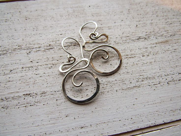 """Simple in their design, but classy in their look, the Sterling Silver Swirl earrings are elegant and light weight! Thick sterling silver is hand formed, textured by hammering. Earrings are 1 1/2"""" long"""