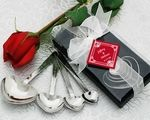 """Set of 4 stainless steel measuring spoons with both traditional measurements and measurements of love. Each set of 4 spoons features """"measures of love"""" on one side with traditional measurements on the other. """"A Pinch of Patience"""""""