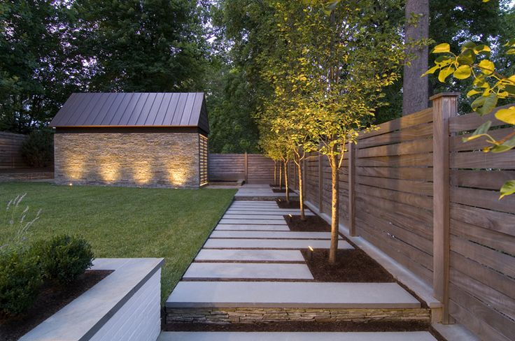 I love how neat this is with the stone and concrete, and I especially love the lights on the shed.  It would be super easy to mow - just want a little less concrete and a little more grass.    Peterson Residence / Robert Gurney 2