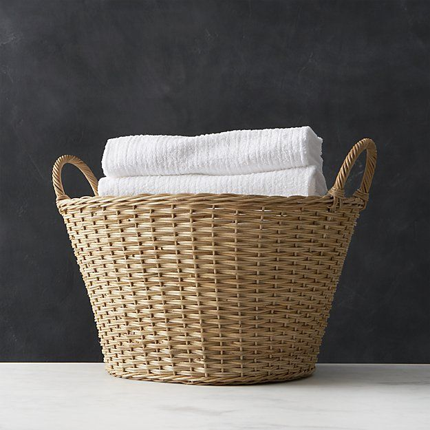 Tote a basket of fresh, folded laundry with this washday classic, handwoven in the Philippines by skilled local artisans. Tapered open basket of 100% natural rattan features sturdy loop handles for a good grip. A matte lacquer finish protects the natural honey hue.