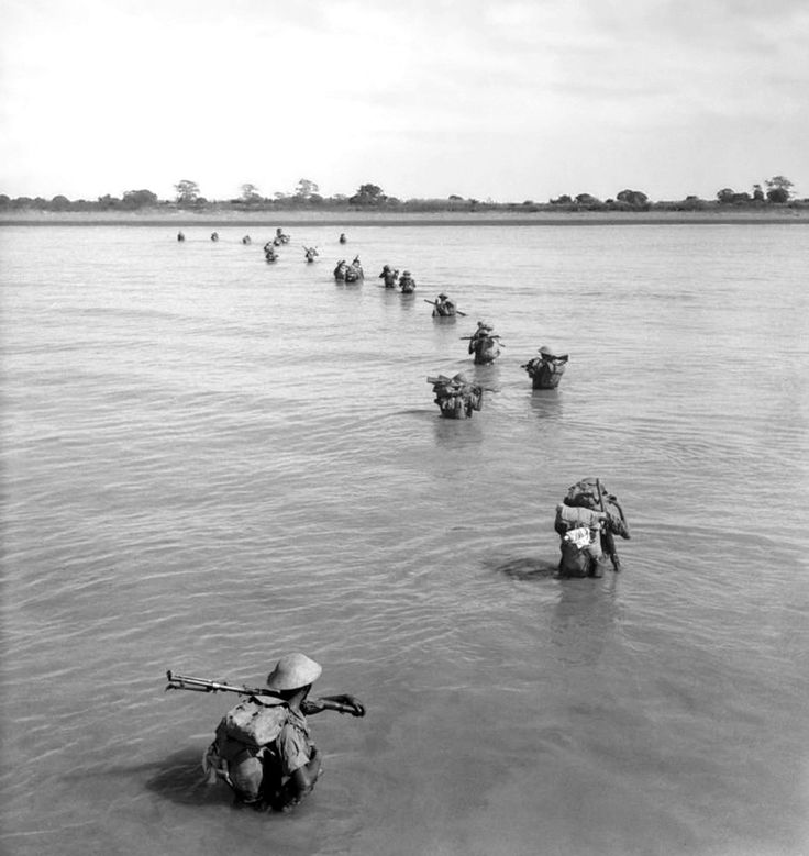 Indian Army soldiers wade ashore at Akyab to battle the Japanese during the Burma Campaign. Akyab (now, Sittwe), Rakhine State, Burma (Myanmar). January 1945.