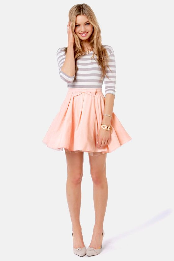 Horizontal grey and white striped top with a beautiful soft pink skirt.