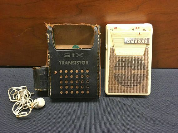This is an early 1960s orange (salmon colored) and cream Omegas Six Transistor pocket radio in its original case with attached matching earphone case and original earphone. To test it, I put in a new Duracell 9-volt battery since there wasnt a battery in it when I opened it. I could