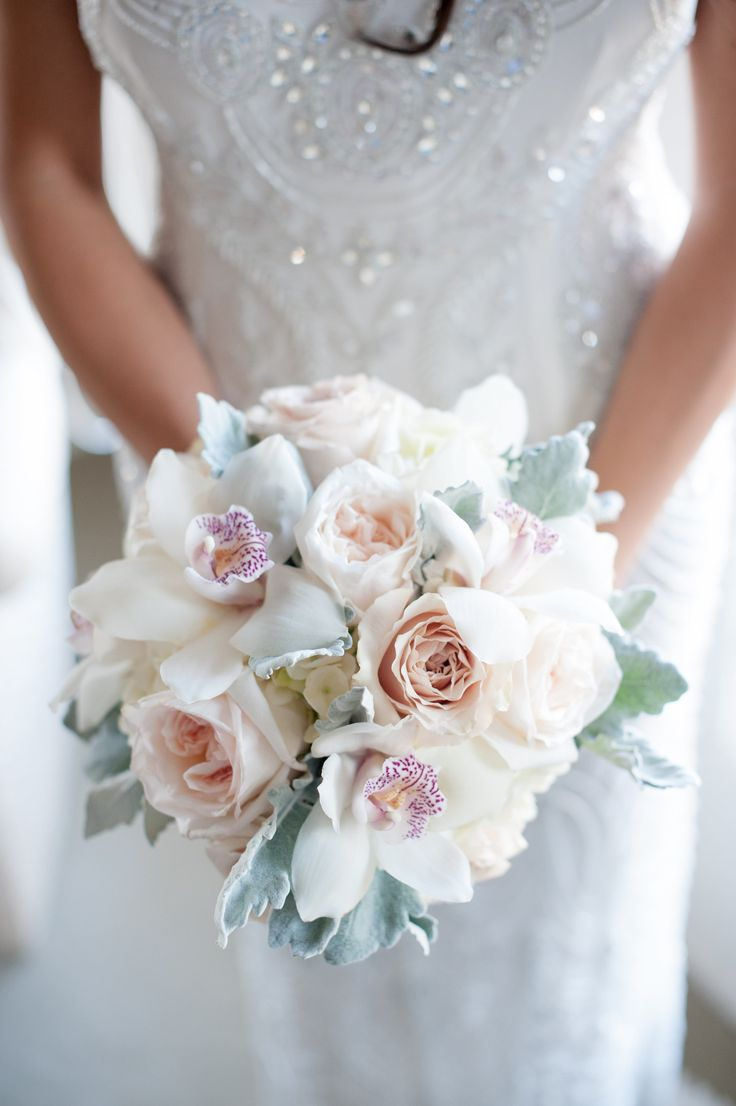 #Roses and #Orchids - Doesn't get any prettier!  See the wedding on SMP -  http://www.StyleMePretty.com/canada-weddings/alberta/edmonton/2014/01/10/elegant-alberta-wedding-at-the-fairmont-hotel-macdonald/ FO Photography