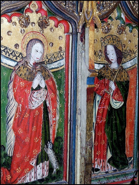 St Agnes and St Edward the Confessor, c.1500, a rood-screen painting at the church of St Peter and St Paul, Eye, suffolk; St Agnes is shown with her lamb attribute, and St Edward the Conffessor with his royal crown and sceptre. (Photograph: Simon_K, via Flickr)